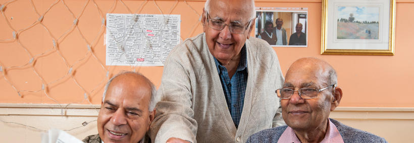 Image of older men looking at a document